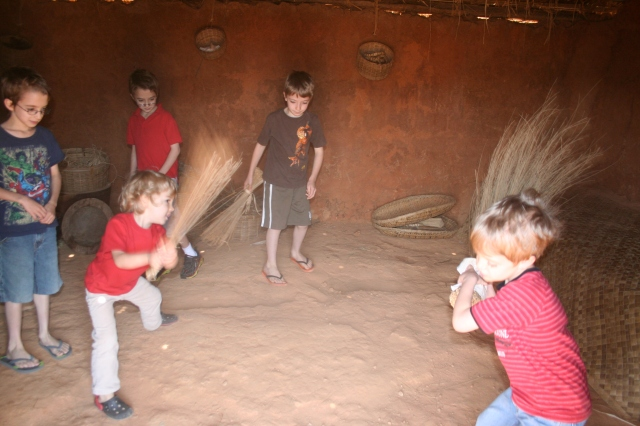 Sweeping (or sword fighting) at the African village.