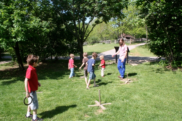 Playing horse shoes at the English farm.