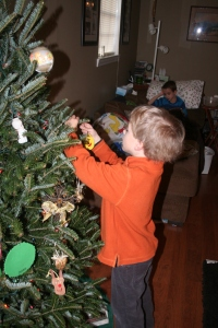 Gabriel hanging ornaments. Stephen was sick and watched from the couch.